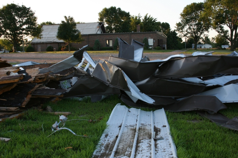A debris pile on the edge of the church parking lot includes pieces of steel from the roof and brick from the bell tower. Photo taken in September 2011.