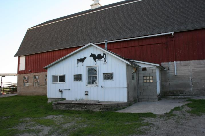 Notice the cow art on the milkhouse in this image taken this past summer.