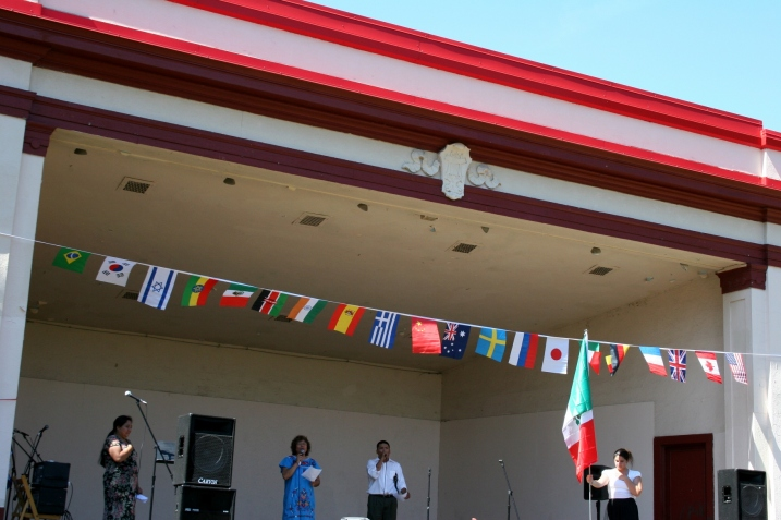 Several Latinos lead in singing of Mexico's national anthem last September during the International Festival Faribault at Faribault's Central Park.