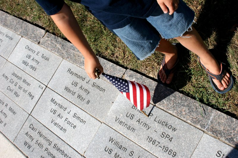 A young boy peruses the pavers honoring veterans at the Rice County Veterans Memorial in Faribault.