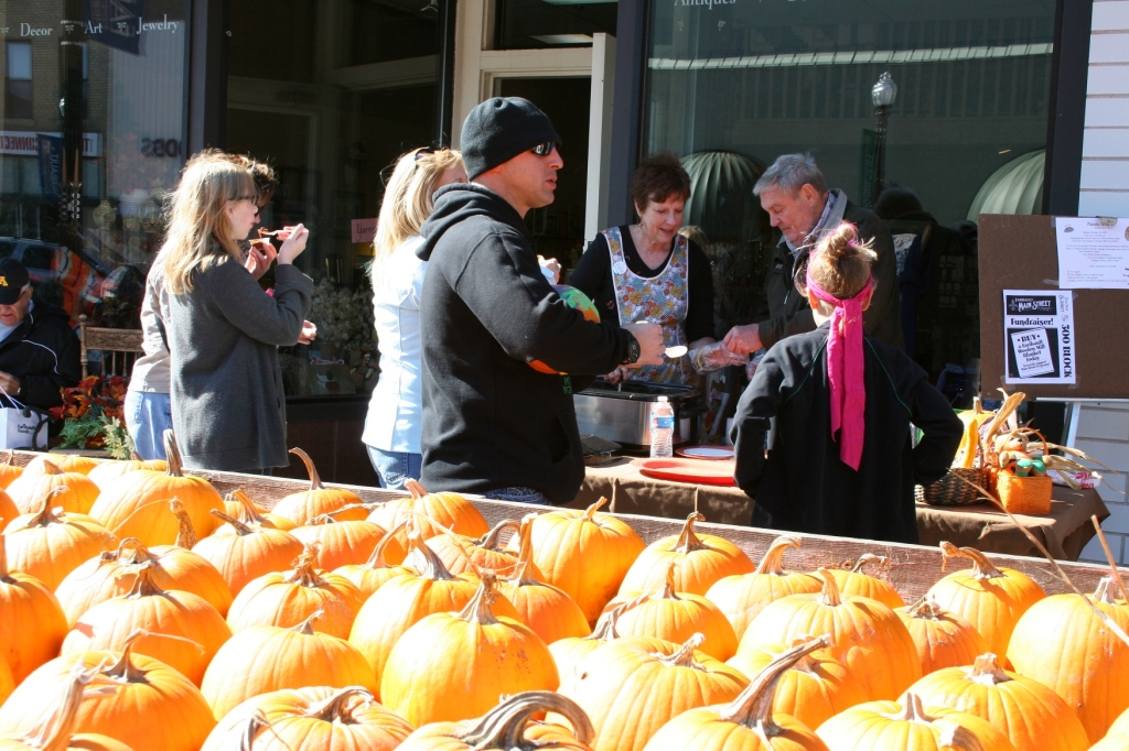 Participants in last year's Chili Contest dish up chili at a business along Central Avenue during the Fall Festival.