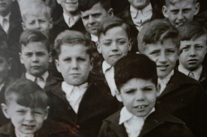 A photo of some of the school's residents on exhibit in Cottage 11, which housed boys ages 6 - 13.