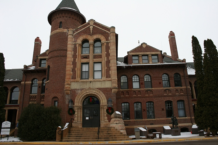 The main building at the orphanage, built in 1886, housed offices, a reception room, chapel/auditorium, boys' cottage, living quarters for employees, a sewing room, attic and linen storage. This main portion today serves as the Owatonna city administration building.