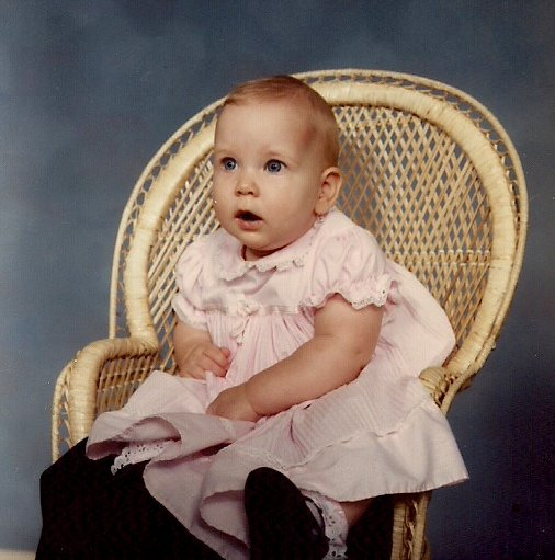 Amber in 1986, sometime during her first year of life. The photo is not dated. A friend told me she looked just like the baby on the Gerber baby food jars.