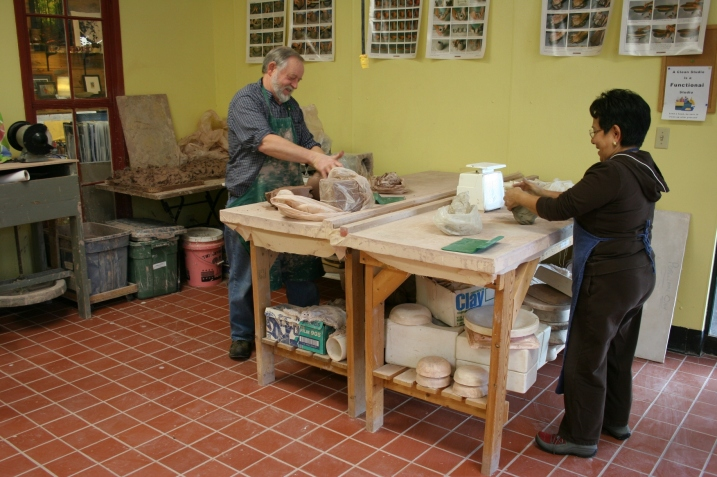 Joel Moline and Thalia Taylor kneading clay during a visit to the Clay Center in March 2012..