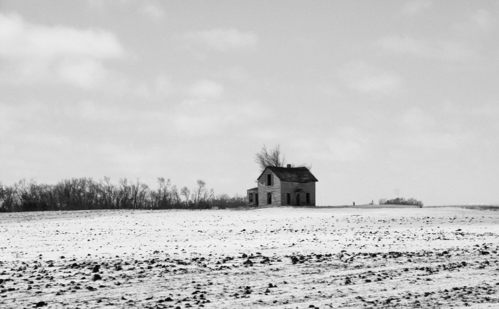 An abandoned farmhouse along Minnesota State Highway 19 east of Vesta on the southwestern Minnesota prairie.