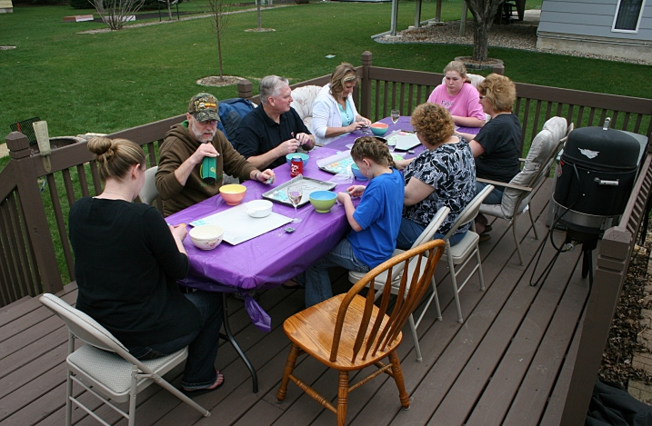 A new generation of mint-makers crafted mints Saturday afternoon on my sister Lanae's deck. I took a break (that's my empty chair in the front) to photograph the event.