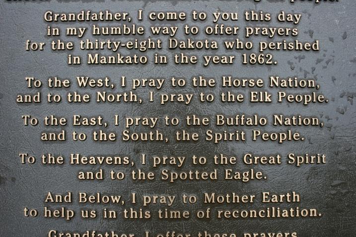 Words on a marker in Reconciliation Park in Mankato where 38 Dakota were hung on Dec. 26, 1862.
