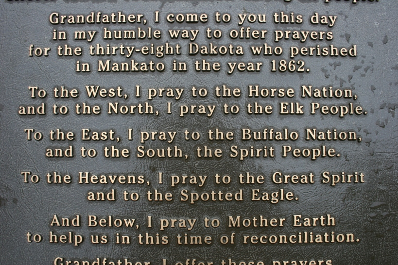 Words on a marker in Reconciliation Park in Mankato where 38 Dakota were hung on Dec. 26, 1862.