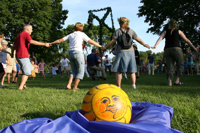 Dancing around the maypole with a sun ball, from an earlier game, resting nearby.