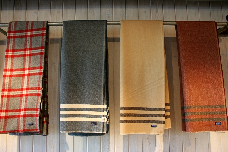 Faribault Woolen Mill blankets/throws are artfully hung on a simple pipe.