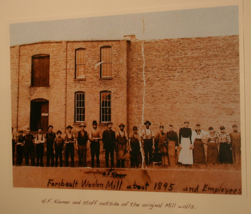 An historic photo from the mill, among those showcased in a mini wall of Woolen Mill history.