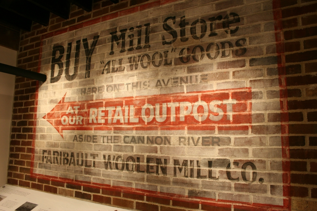 A replica of an original sign is now in the Woolen Mill's historic display area.