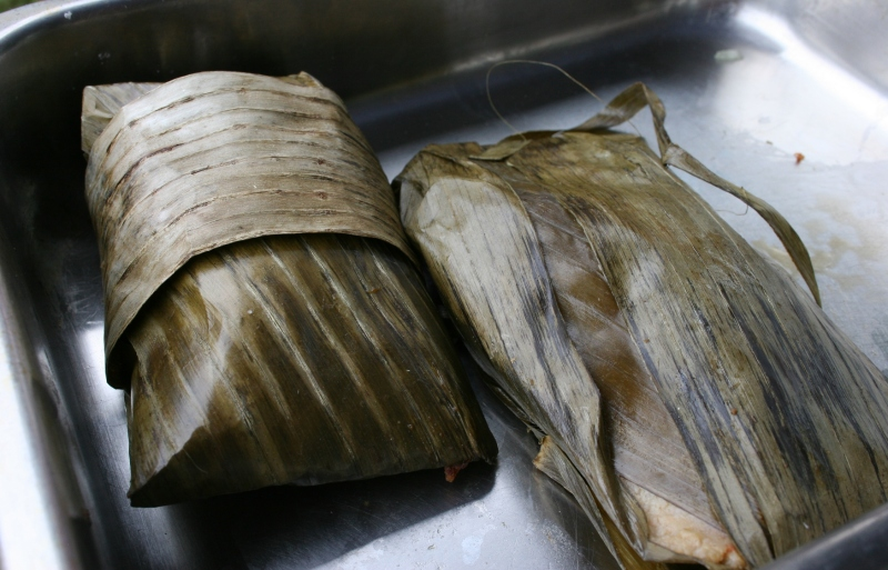 A Mexican dish (help me out if you know, but I think tortillas) was wrapped in banana leaves. My husband and I tried this.