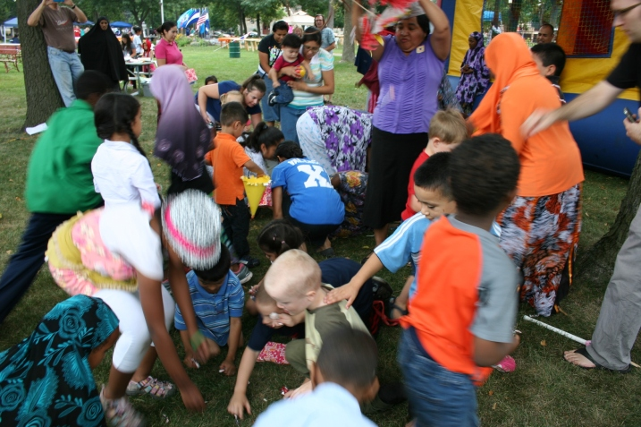 The scramble for candy once one of three pinatas is broken.