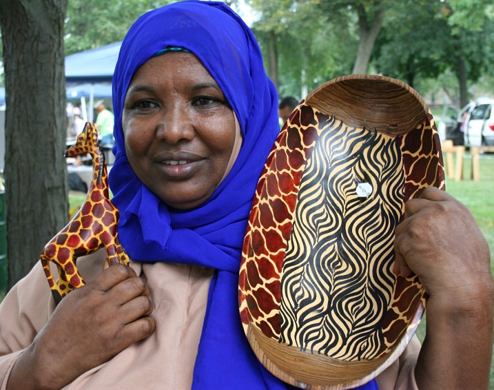 Lul Abdi shows off beautiful wood crafts from Kenya and Somalia.