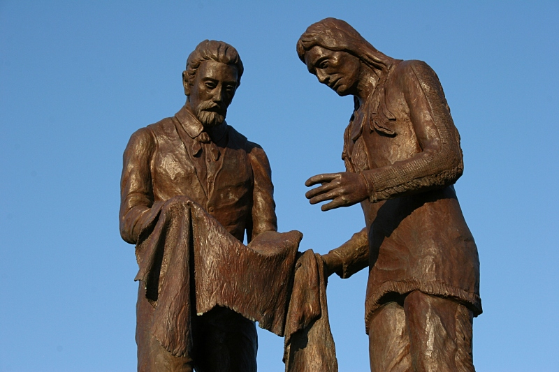 This sculptor of Alexander Faribault trading with a Dakota trading partner stands in Faribault's Heritage Park near the Straight River and site of Faribault's trading post. Faribault artist Ivan Whillock created this sculpture which sits atop a fountain known as the Bea Duncan Memorial Fountain.