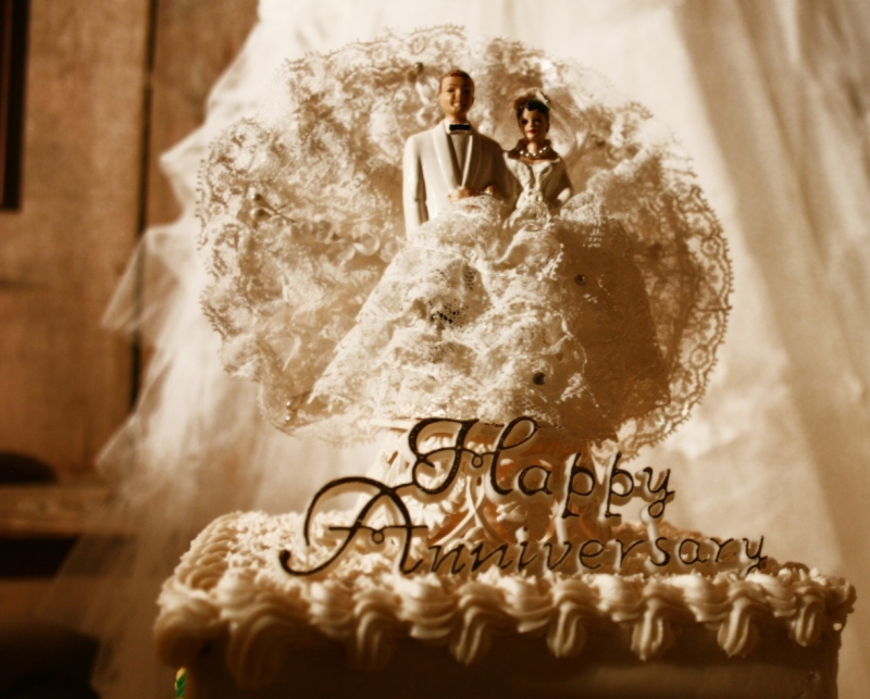 The cake topper from Jeanne and Arnie's wedding with golden anniversary wishes 50 years later.