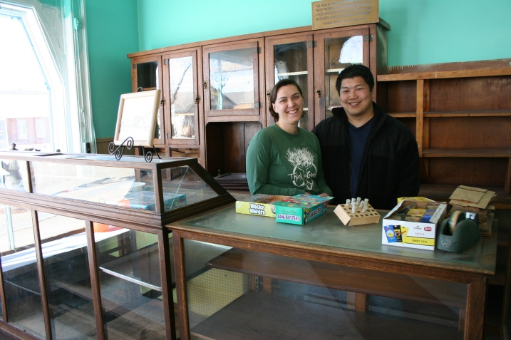 David and Michelle posed behind the original candy counter last fall. Michelle has sweet memories of coming here for candy as a child. Minnesota Prairie Roots file photo.