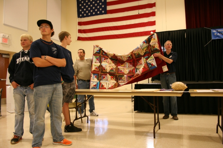 Auctioning of beautiful pieced quilt at the CVLHS live auction.