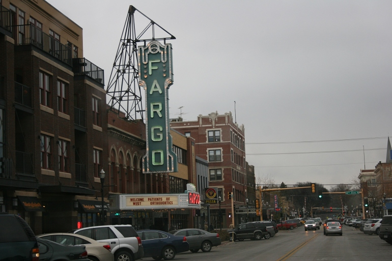 A view of the 300 block on North Broadway, including signage for the Fargo Theatre, built in 1926 as a cinema and vaudeville theatre. The theatre is on the National Register of Historic Places and serves as a venue for independent and foreign films, concerts, plays and more.