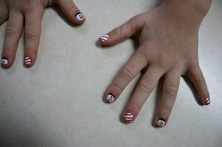 Nevaeh's cute, cute holiday painted fingernails.