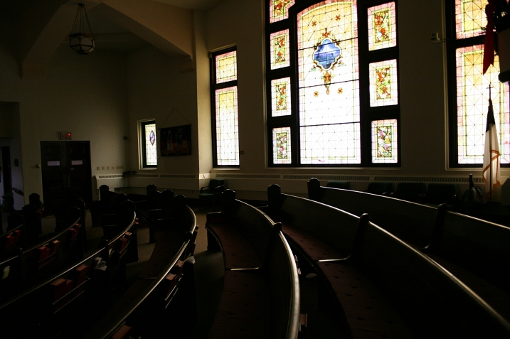 A snippet of the pews and beautiful stained glass window.