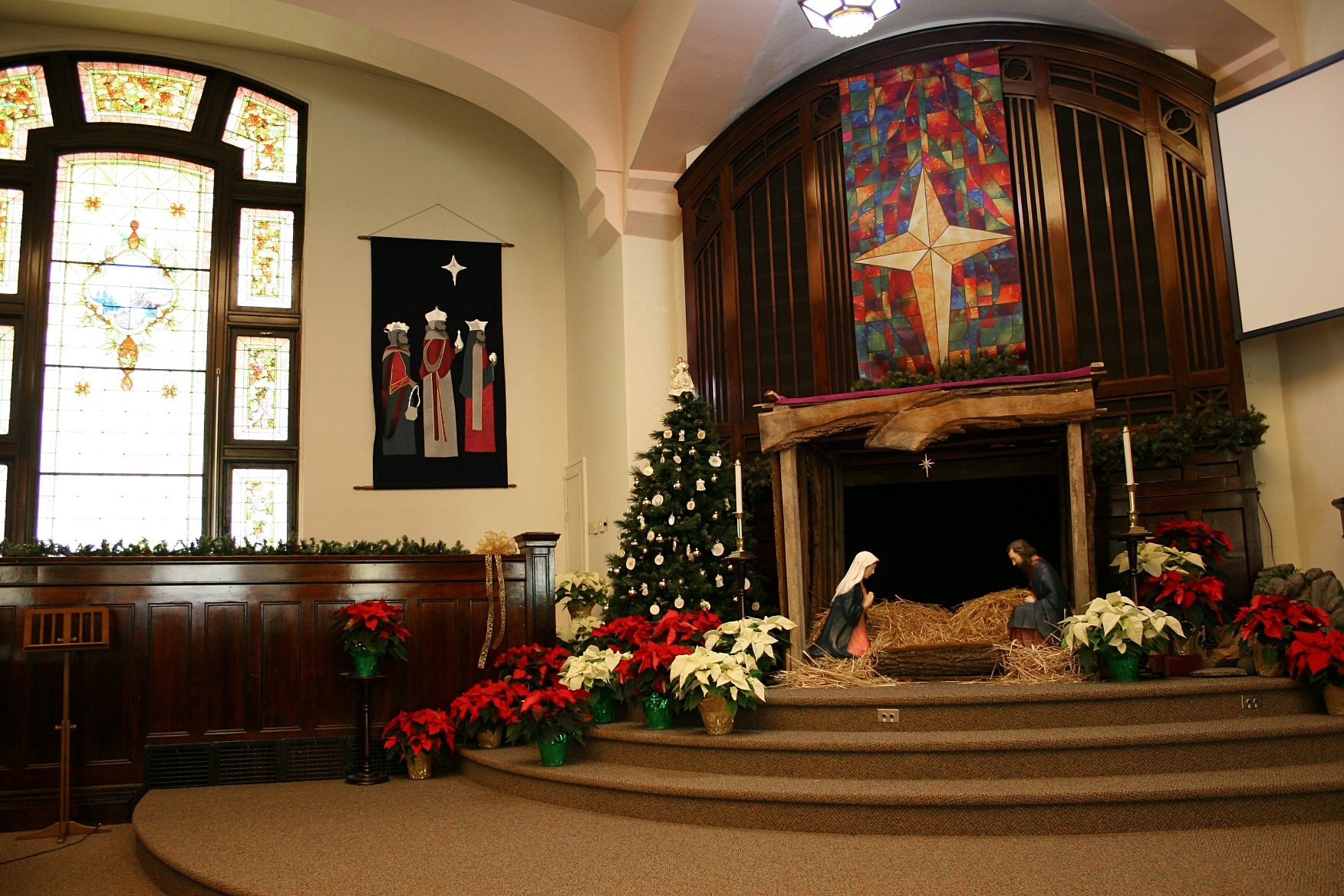 Focusing on the altar area and the eastern stained glass window.