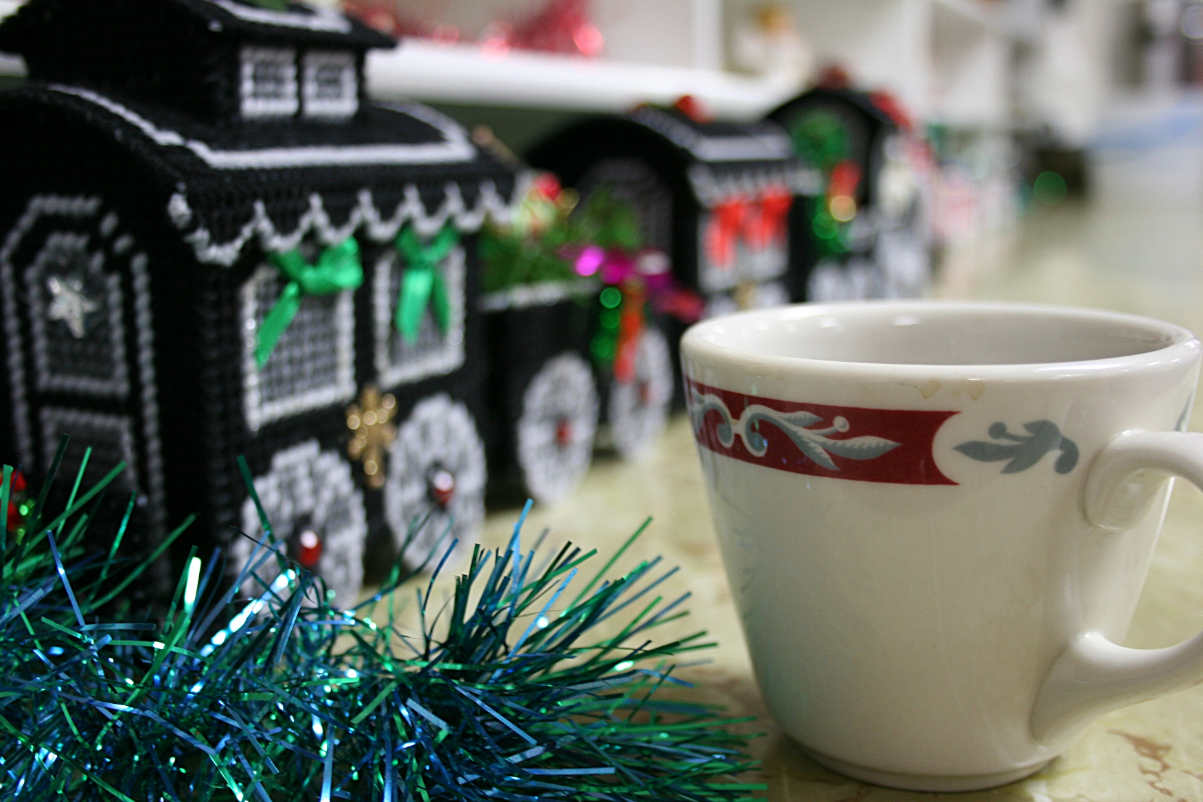 I noticed this full coffee cup setting on a cupboard lined with holiday decorations. During the congregation's Lenten soup luncheons, desserts fill the shelves.