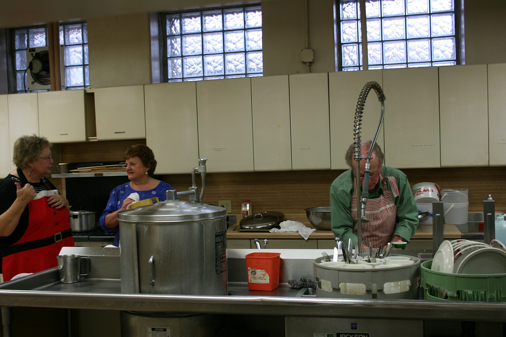In the kitchen, a team of workers tended the food and washed the dishes, etc.