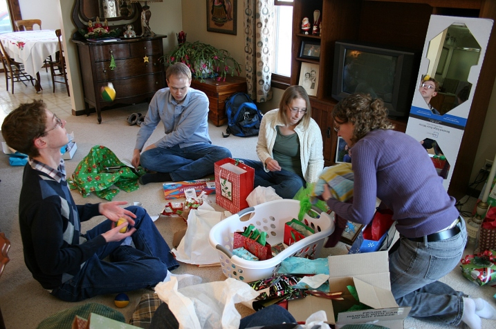 My three, plus the eldest daughter's boyfriend, Marc, opened gifts Christmas Eve afternoon. Caleb is juggling on the left with his new juggling balls.