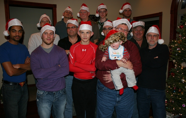 I decided the men needed hats, too, so I brought Santa hats for them to model in a serious pose.
