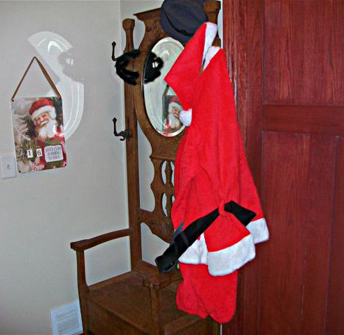 My brother apparently has VIP access to Santa's wardrobe. Photo by Brian Kletscher.