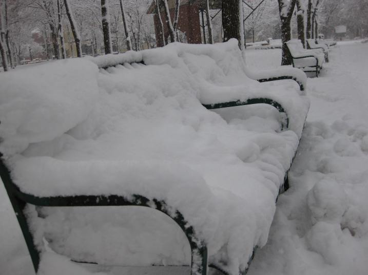 Snow layers benches in Mears Park early this afternoon. Photo by Marc Schmidt.