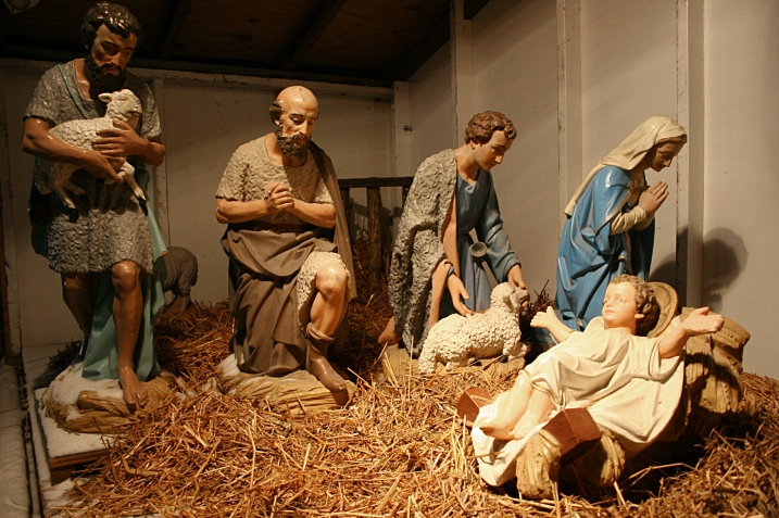 One side of the scene shows the shepherds in the stable.