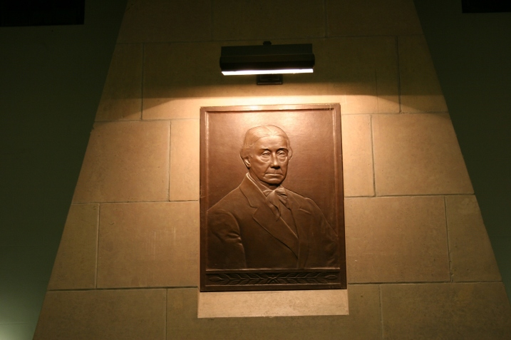 I believe this is a bust of Judge Thomas Scott Buckham, after whom the library is named. His wife, Anna, gifted the city of Faribault with this Art Nouveau/Greek Revival style building constructed in 1929-1930. The bust is located above the fireplace in the Great Hall, right behind where Peter and I presented.