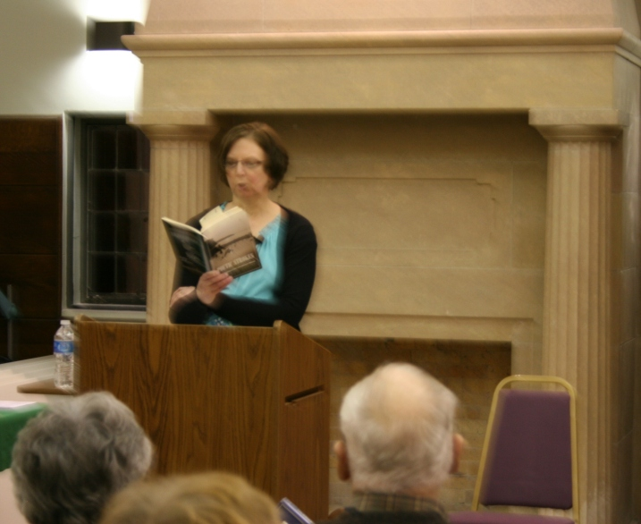 "Me reading ""Prairie Sisters,"" my first poem of the evening. The poem was published in volume two of Poetic Strokes."