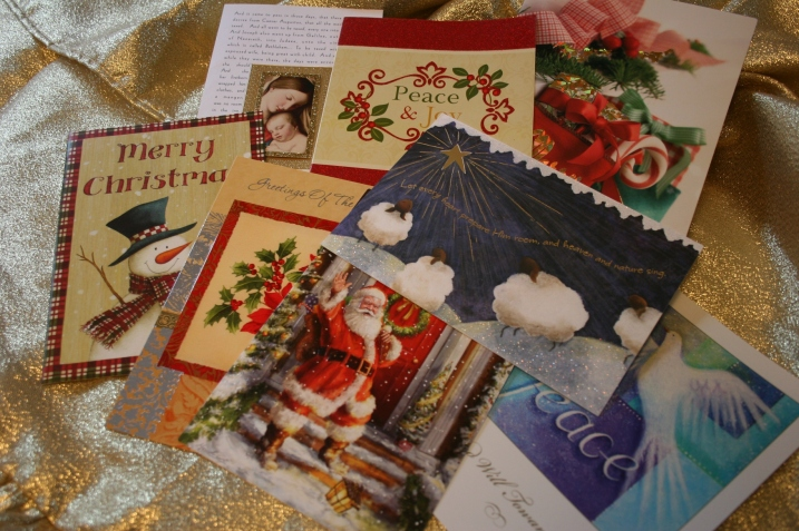 Examples of Christmas cards in my stash that could be recycled into gift tags.