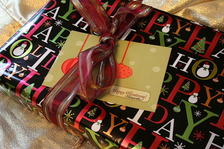 A recycled ribbon and card grace this package.