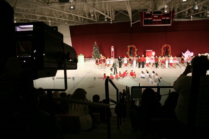 "The spotlight and cameras focus on ""The Nutcracker on Ice"" figure skaters."