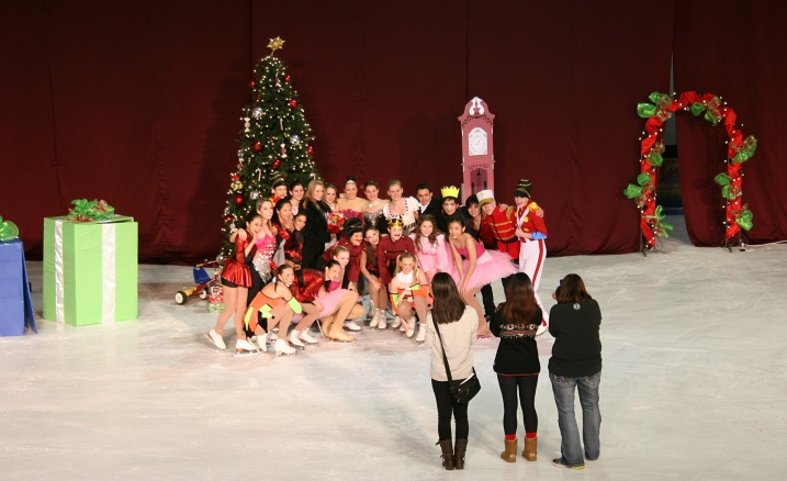The skaters pose for post performance photos.