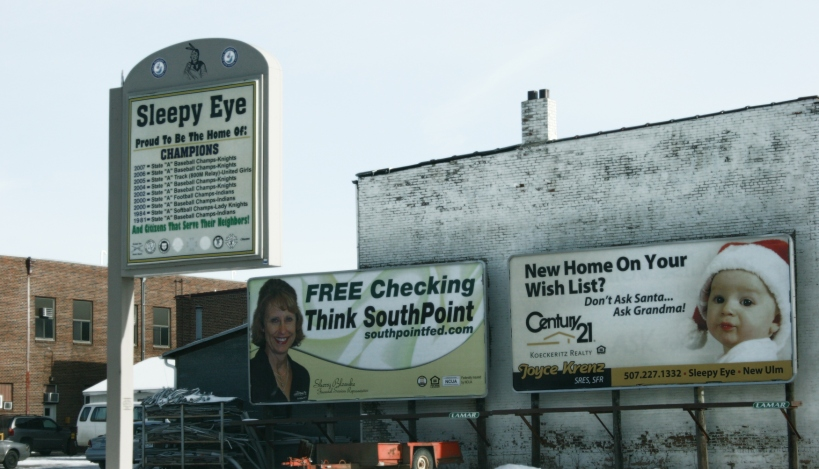 This creative real estate billboard in Sleepy Eye, at the intersections of U.S. Highway 14 and Minnesota Highway 4, makes me smile. A nearby sign boasts the local high school's athletic accomplishments.