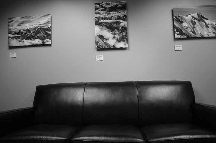 A photo in a cozy private waiting room fronts Tom Fakler's Swiss Alps photos.