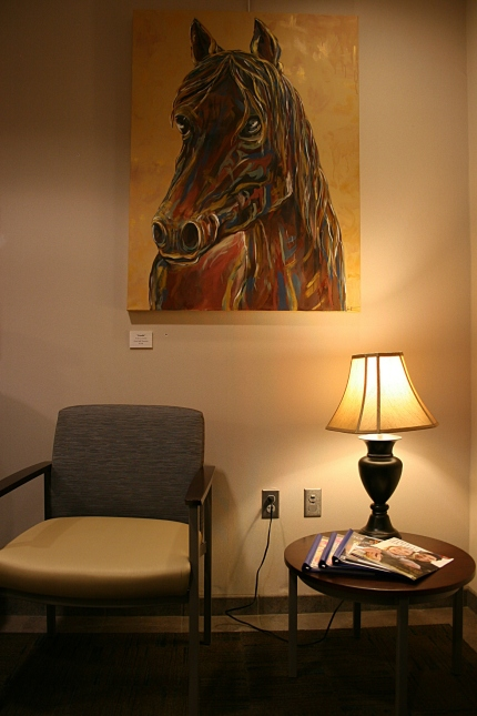 Tucked into a corner by the elevators, the fourth of Hanscom's horse oil paintings.