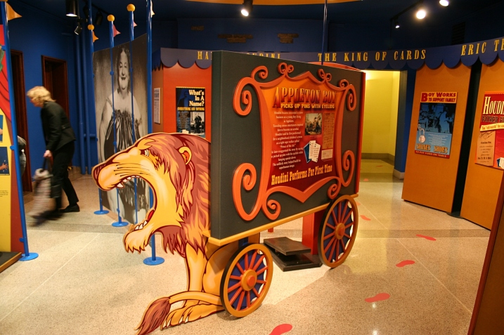 """The circus wagon in the exhibit is a nod to Houdini's circus association. He first performed for a neighborhood children's circus as tight roper walker """"Prince of the Air."""""""