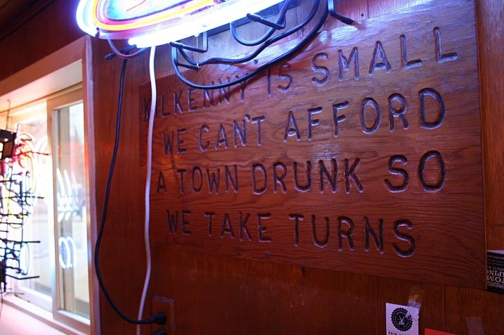 Kilkenny bar humor posted below the Bud Light sign.
