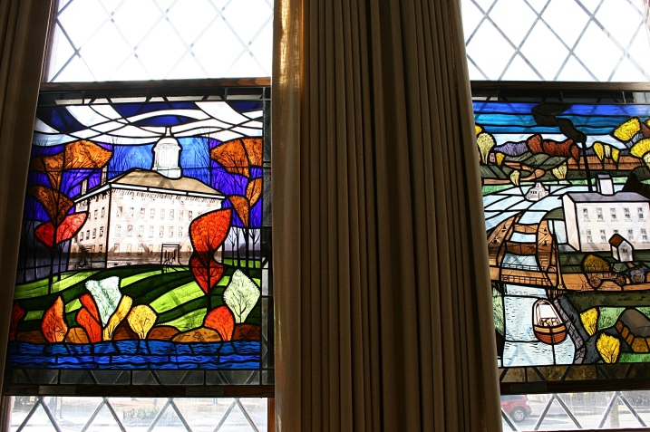 Windows in the Siekman Room depict the history of the Fox Cities from the days of the early explorers until modern times.