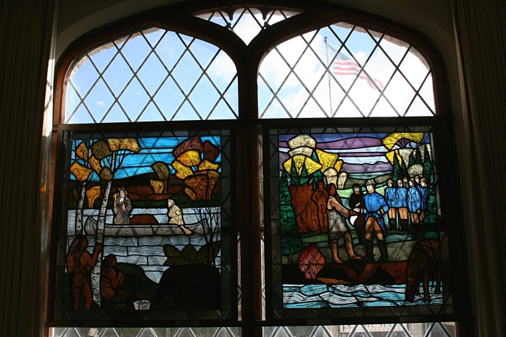 Windows depicting the region's early fur trading history.