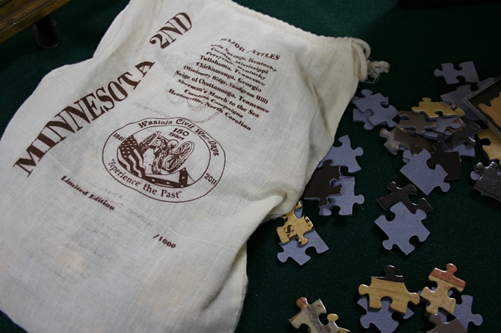 This cloth bag holds the puzzle pieces and informational sheets.