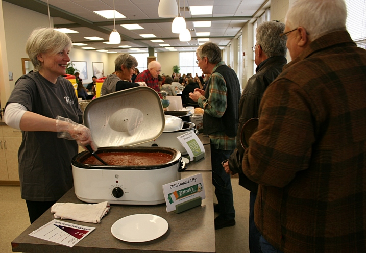 Diners line up for soup or chili. Seconds could be had for a freewill donation.